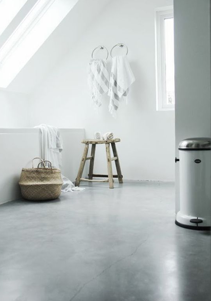 A bathroom with a polished concrete floor