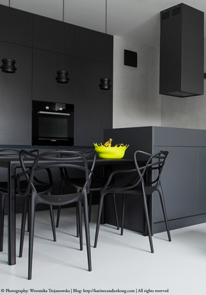 black kitchen with Philippe Starck Masters chairs
