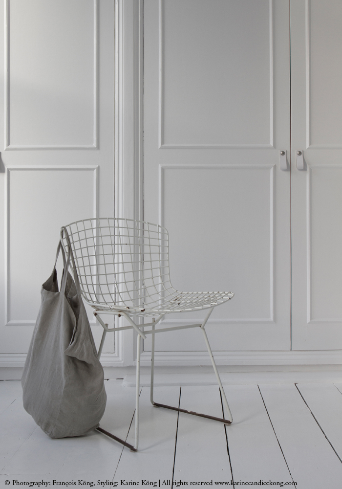 leather door handles, white floorboards, linen bag, Bertoia chair