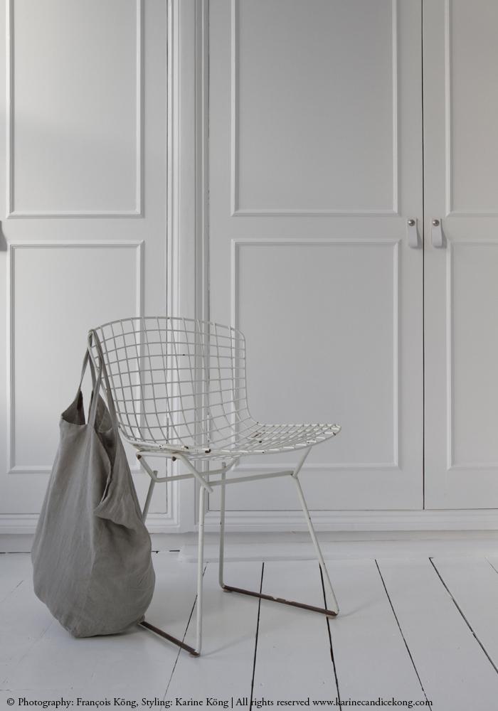 leather door handles, white floorboards, linen bag, Bertoia chair