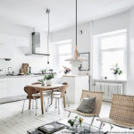 A white apartment with natural accents
