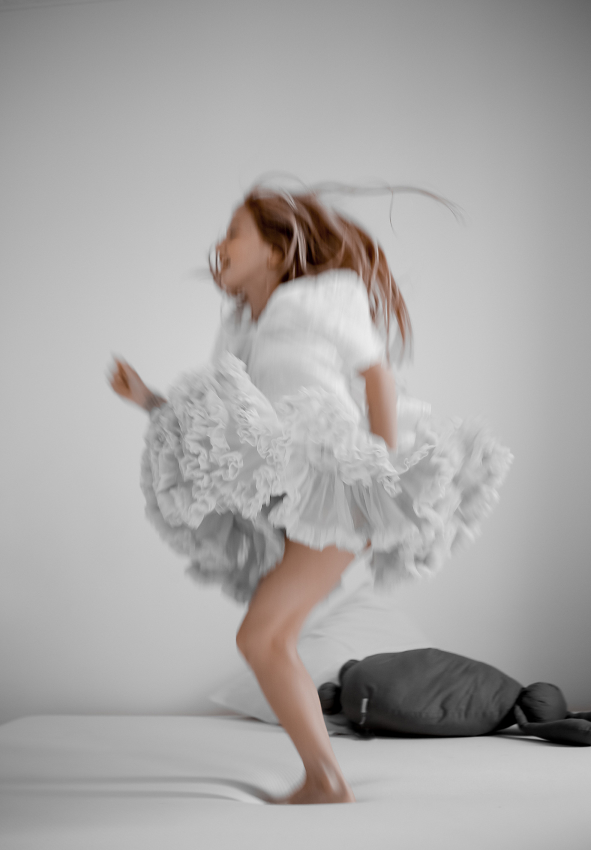 Kid jumping on bed © Karine Kong Photography, All Rights Reserved.jpg